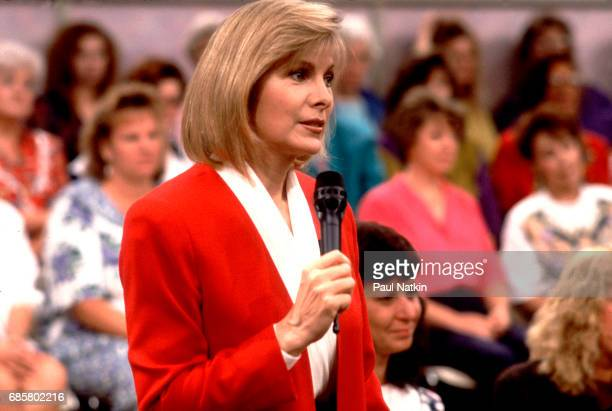 Television host Jenny Jones speaks with members of the audience during her talk show Chicago Illinois September 11 1991