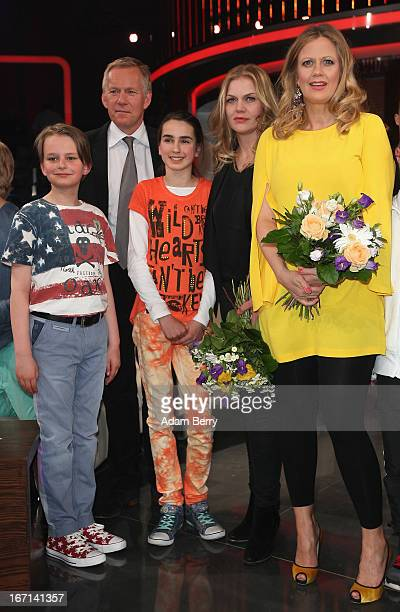Television Host Johannes Kerner and actresses Anna Loos and Barbara Schoeneberger pose with child contestants at a photo call for the Das Erste...