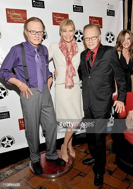 Television Host Larry King and actress/singer Shawn Southwick King pose with the life like copy of Larry King from Madame Tussauds at the Hollywood...