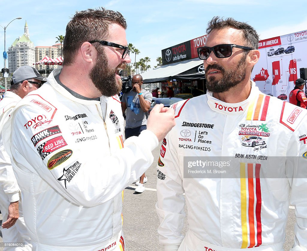 Television host Rutledge Wood (L) and actor Brian Austin Green wait for the start of the practice session for the 42nd Toyota Grand Prix of Long Beach Press Day on April 5, 2016 in Long Beach, California.