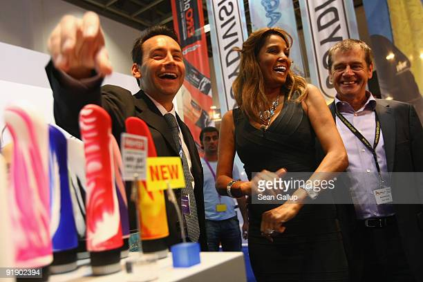 Television hostess and singer Nadja Abd el Farrag alias 'Naddel' and this year's face of the Venus erotic trade fair visits a stand featuring dildos...