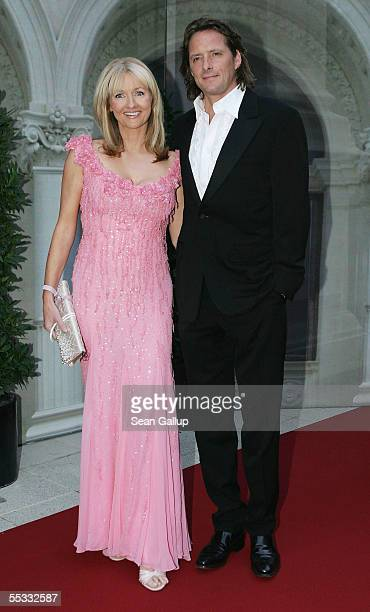 Television hostess Frauke Ludowig and her husband Kai Roeffen arrive at the evening reception after the church wedding of Verona and Franjo Pooth at...