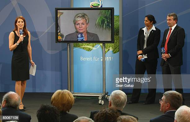 Television hostess Monica Lierhaus leads discussion with German national women's football team coach Silvia Neid as German Football Federation...