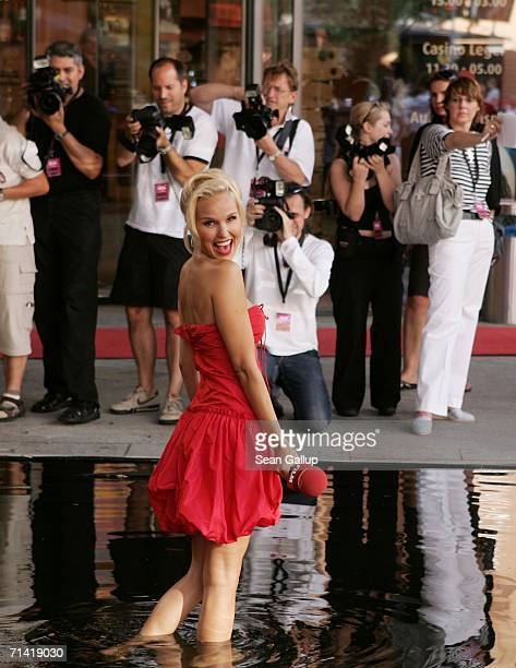 """Television hostess Tamara Sedmak takes a dip at the German premiere of """"Poseidon"""" July 11, 2006 at the Berlinale Palast in Berlin, Germany."""