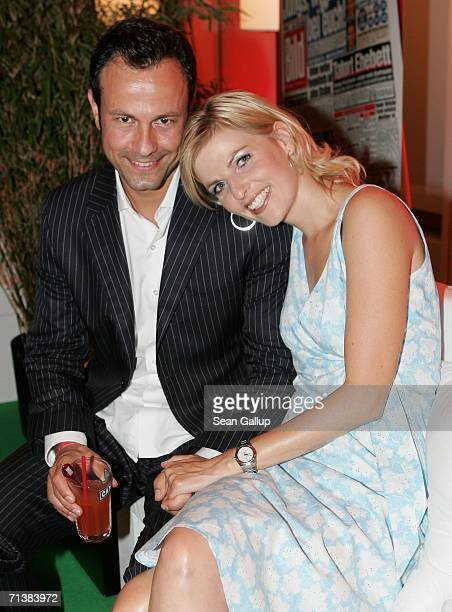 Television hostess Tanja Buelter and friend Moritz Quiske attend the Bild Summer party July 6, 2006 in Berlin, Germany.