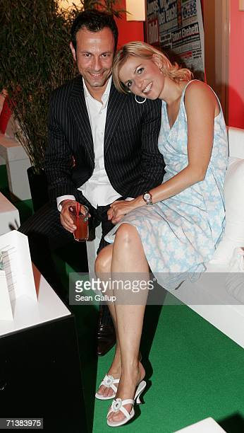 Television hostess Tanja Buelter and friend Moritz Quiske attend the Bild Summer party July 6 2006 in Berlin Germany