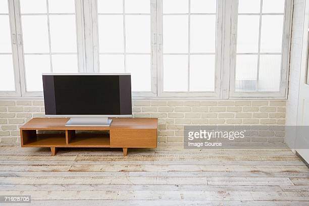 Television in sparse room