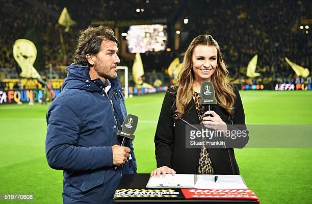 Television interviewer Laura Wontorra interview KarlHeinz Riedle before the UEFA Europa League quarter final first leg match between Borussia...