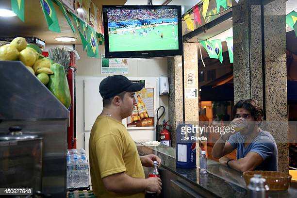 A television is tuned in to the England vs Italy 2014 FIFA World Cup match at a cafe on June 14 2014 in Rio de Janeiro Brazil Italy won the match 21