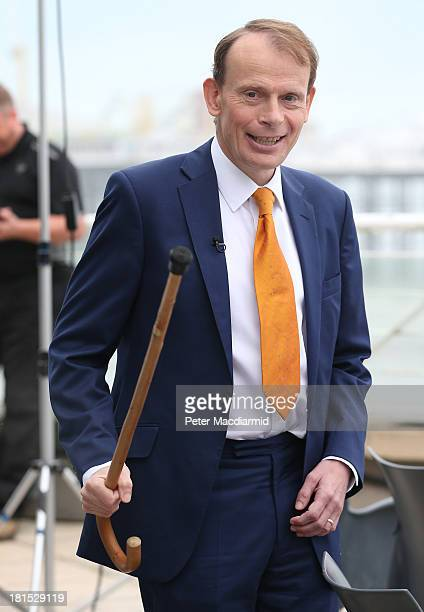 BBC television journalist Andrew Marr gestures to photographers as he waits to interview Labour Party Leader Ed Miliband on September 22 2013 in...