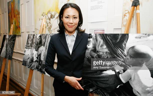 """Television journalist Ann Curry stands with her photos from Sudan at Refugees International's """"Images of Tragedy and Hope in Sudan"""" at The National..."""