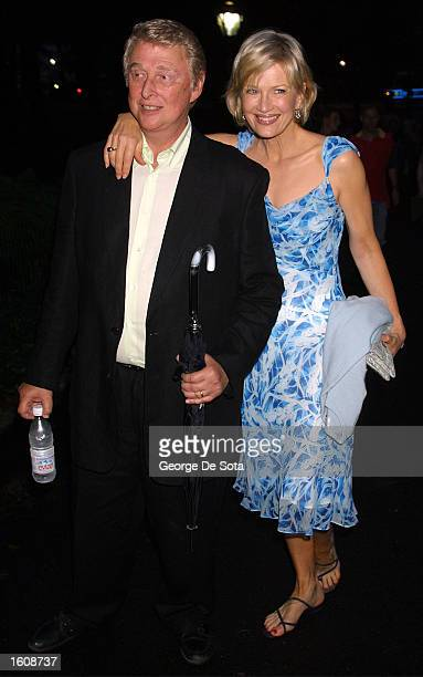 """Television journalist Diane Sawyer and husband director Mike Nichols attend a rainy openning night of """"The Seagull"""" August 12, 2001 at the Delacorte..."""