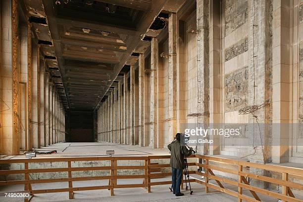 A television journalist films a disused hall blackened by departing Soviet troops in 1945 at Tempelhof Airport June 29 2007 in Berlin Germany...