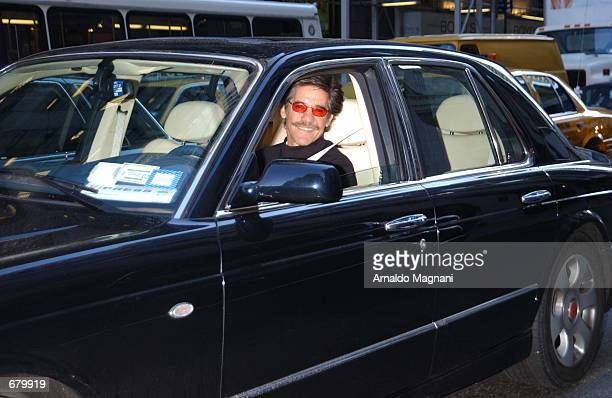 Television journalist Geraldo Rivera drives his Bentley along Madison Avenue November 6 2001 in New York City before heading off to Central Asia on...