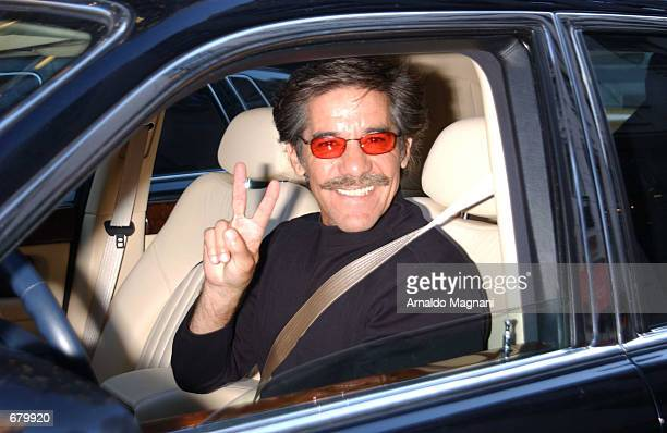 Television journalist Geraldo Rivera flashes a Vsign while driving his Bentley along Madison Avenue November 6 2001 in New York City before heading...