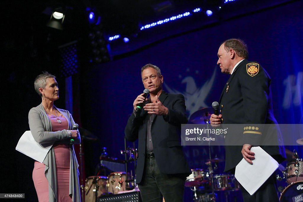 Television journalist Jennifer Griffin, actor/musician Gary Sinese and ret. fire captain John 'Woody' Woodall appear on stage during the Rock The Boat Fleet Week Kickoff Concert held at Hard Rock Cafe, Times Square on May 21, 2015 in New York City.