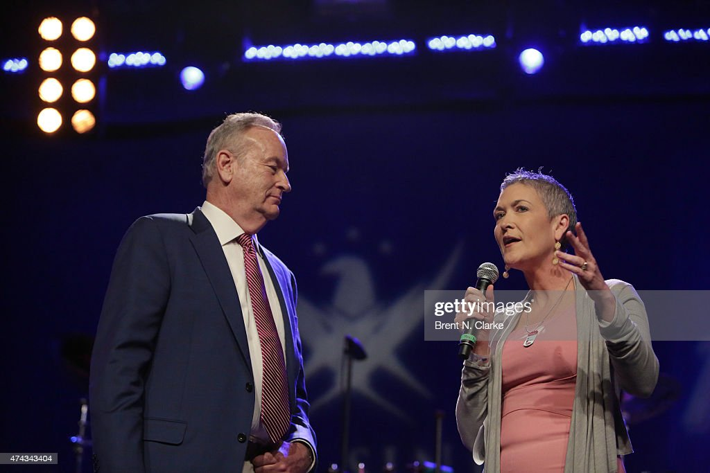 Television journalist Jennifer Griffin (R) speaks on stage as political commentator Bill O'Reilly looks on during the Rock The Boat Fleet Week Kickoff Concert held at Hard Rock Cafe, Times Square on May 21, 2015 in New York City.