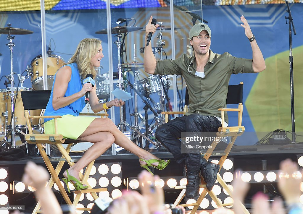 Television journalist Lara Spencer (L) interviews singer Enrique Iglesias before he performs On ABC's 'Good Morning America' at Rumsey Playfield, Central Park on August 1, 2014 in New York City.