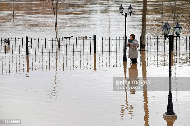 A television journalist standing in floodwaters reports the situation in Tordesillas after the Duero river overflowed its banks on April 1 2013 Spain...