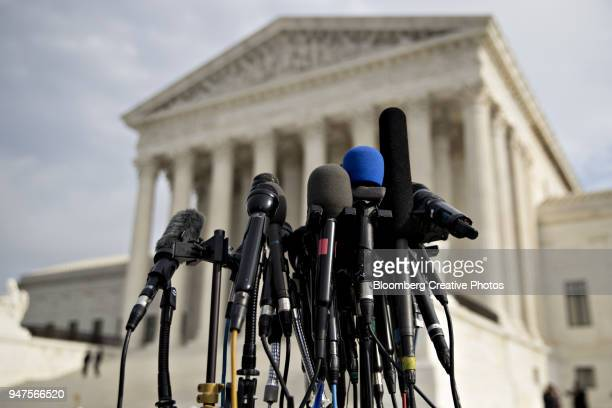 Television microphones stand outside the U.S. Supreme Court