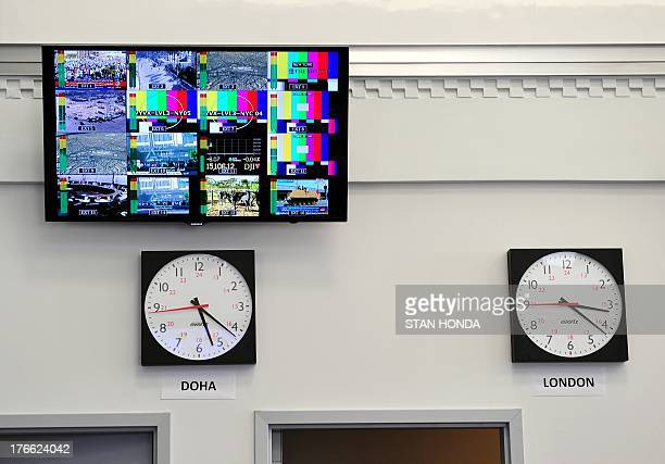A television monitor and world time clocks in the main newsroom area of the new Al Jazeera America television broadcast studio on West 34th Street...