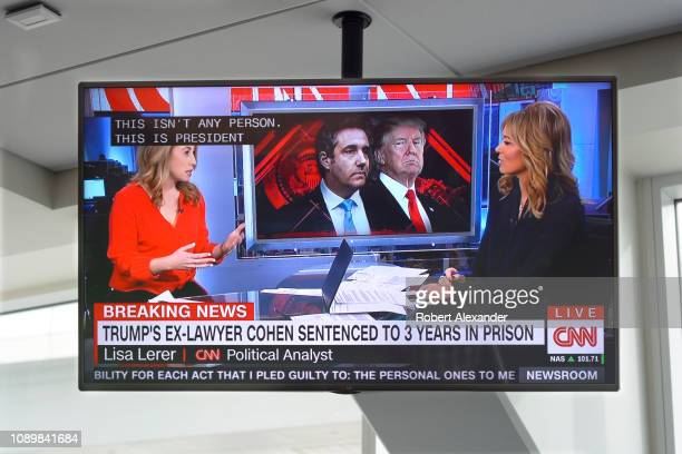 A television monitor at Dallas/Fort Worth International Airport shows a CNN news broadcast with CNN anchor Brooke Baldwin on the day President...