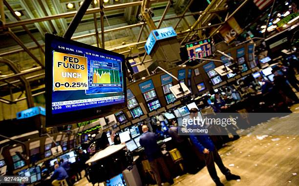 A television monitor displays a graphic about the US Federal Reserve interest rate decision on the floor of the New York Stock Exchange in New York...