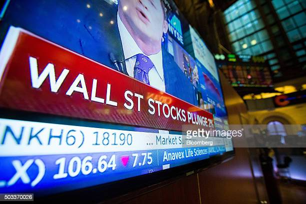 A television monitor displays financial news at the New York Stock Exchange in New York US on Monday Jan 4 2016 US stocks tumbled to start 2016...