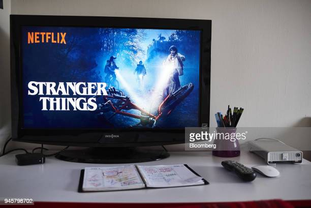 A television monitor displays the home screen for the Netflix Inc original series 'Stranger Things' in an arranged photograph taken in the Brooklyn...