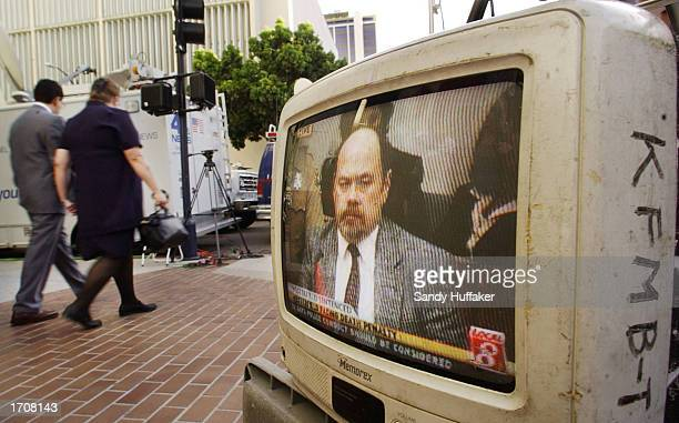 A television monitor shows David Westerfield in court during his death penalty hearing outside Superior Courthouse January 3 2002 in San Diego...