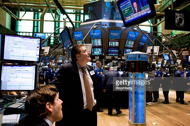Television monitors broadcast a live speech by Fritz Henderson chief executive officer of General Motors Corp as traders work at the New York Stock...