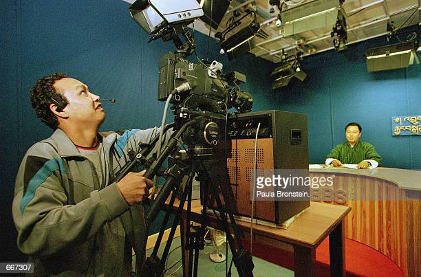 BBS television new anchor Karma Dorjee prepares for the evening news broadcast as the cameraman positions the camera May 9 2000 in Thimpu Bhutan...