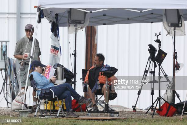 Television news crew arrive at their site to make make preparations for coverage at the the SpaceX Falcon 9 rocket with the Crew Dragon spacecraft,...