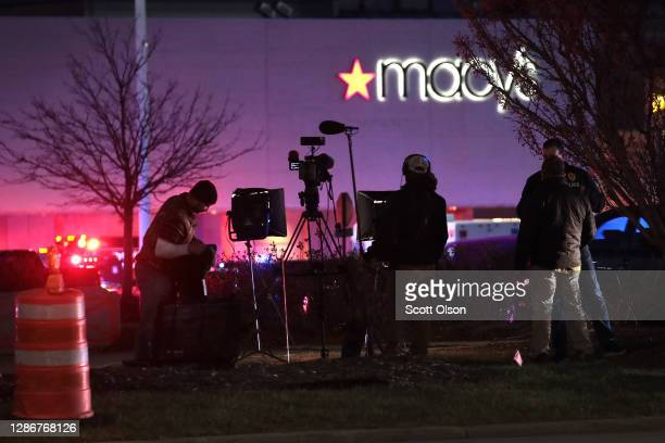 Television news crew reports from outside the Mayfair Mall after a gunman opened fire on November 20, 2020 in Wauwatosa, Wisconsin. Several people...