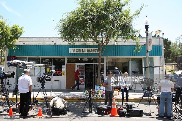 Television news crews occupy the street near a makeshift memorial in front of the IV Deli Mart May 25 2014 in Isla Vista California According to...