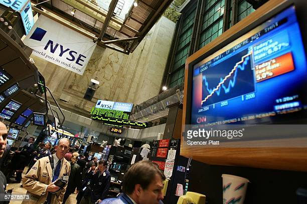 A television news report comments on the raised fed rate on the floor of the New York Stock Exchange May 10 2006 in New York City The Federal Reserve...