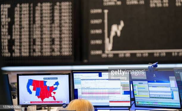 Television news report on the U.S. Presidential election near the DAX Index curve in the Frankfurt Stock Exchange, operated by Deutsche Boerse AG, in...