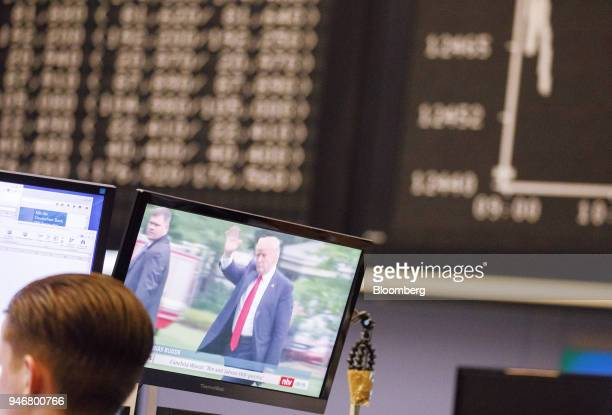 A television news report shows US President Donald Trump inside the Frankfurt Stock Exchange operated by Deutsche Boerse AG in Frankfurt Germany on...