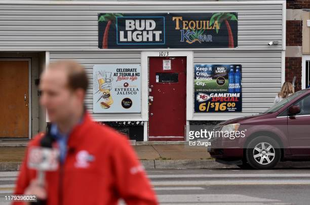 A television news reporter files a story near Tequila KC bar were 9 people were shot and four killed on October 06 2019 in Kansas City Kansas...
