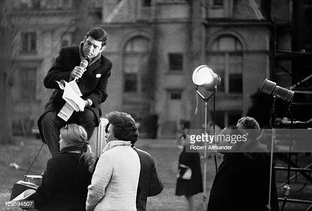 CBS television newsman Dan Rather broadcasts from outside the National Cathedral in Washington DC during the funeral for former president Dwight...