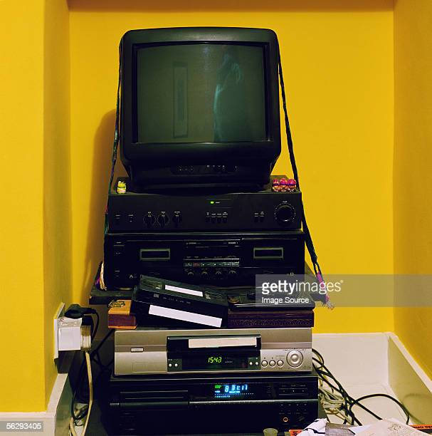 Television on stack of electrical equipment