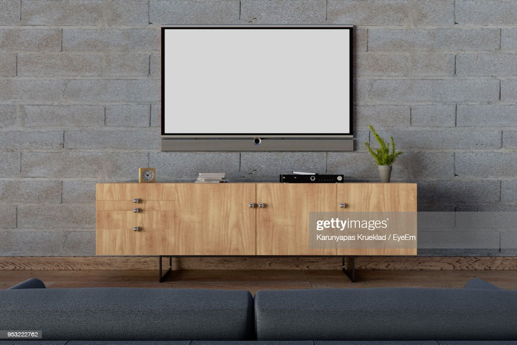 Television Over Cabinet At Home High Res Stock Photo