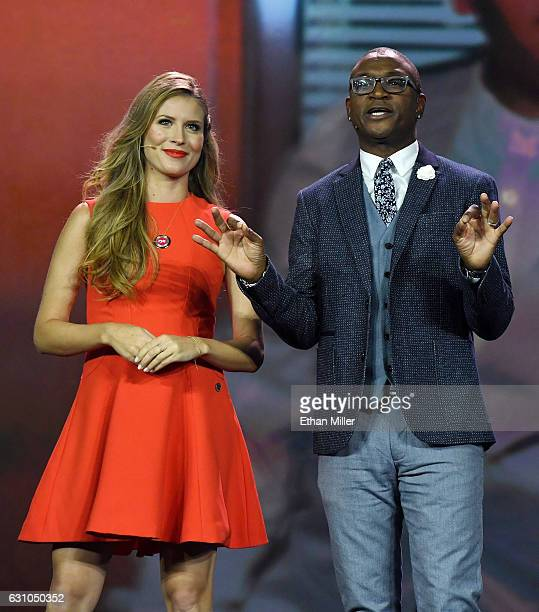 Television personalities Andrea Feczko and Tommy Davidson speak during a keynote address by President and CEO of Carnival Corp Arnold W Donald at CES...