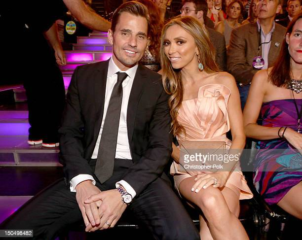 Television personalities Bill Rancic and Giuliana Rancic attend the 2012 Do Something Awards at Barker Hangar on August 19, 2012 in Santa Monica,...