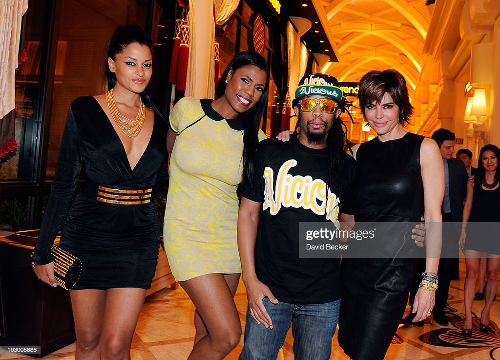 Television personalities Claudia Jordan and Omarosa Manigault, recording artist Lil' Jon and actress Lisa Rinna arrive at the Surrender Nightclub at Encore Las Vegas to celebrate the season premiere of 'All-Star Celebrity Apprentice' on March 2, 2013 in Las Vegas, Nevada.