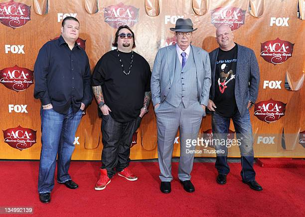 Television personalities Corey Harrison Austin Chumlee Russell Richard Harrison and Rick Harrison of Pawn Stars arrives at 2011 American Country...