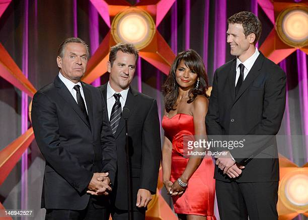 Television personalities Dr Andrew Ordon Dr Jim Sears Dr Lisa Masterson and Dr Travis Stork speak onstage during The 39th Annual Daytime Emmy Awards...