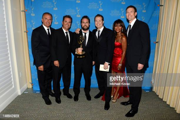 Television personalities Dr Andrew Ordon guest guest Dr Jim Sears Dr Lisa Masterson and Dr Travis Stork pose during The 39th Annual Daytime Emmy...