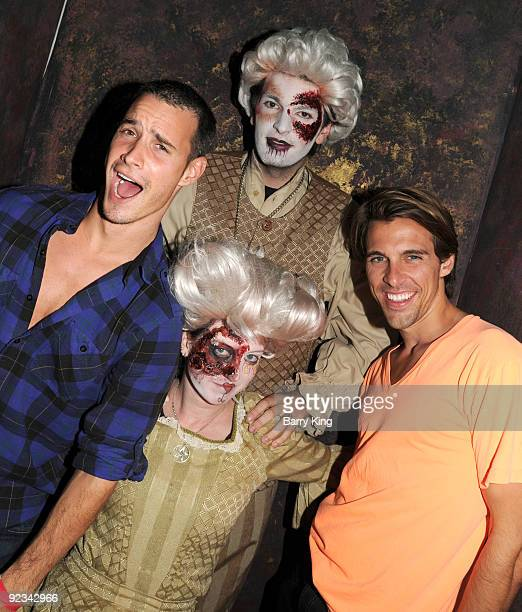 Television personalities Frank Meli and Madison Hildebrand attend Knotts Scary Farm Haunt on October 25 2009 in Buena Park California
