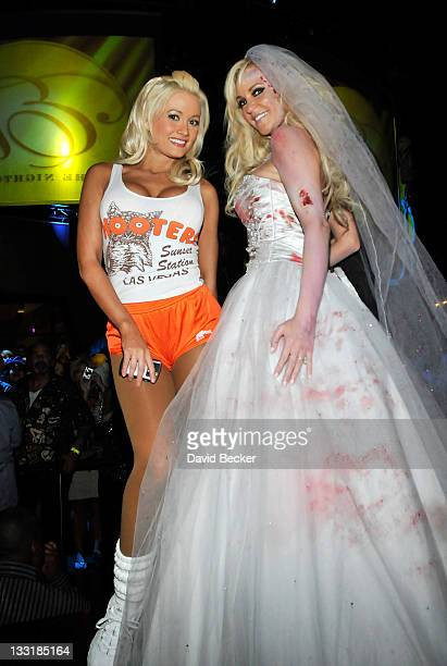 Television personalities Holly Madison and Bridget Marquardt both dressed in costumes attend the Halfway to Halloween party at the Eve nightclub at...